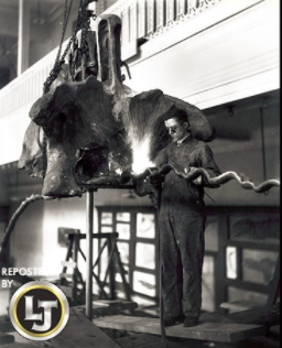 Welding the tail support for Apatosaurus, 1915, Carnegie Museum of Natural History, Pittsburgh, PA.